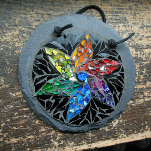 Color Wheel Starflower by Nutmeg Design. Glass on slate, 5 inches.