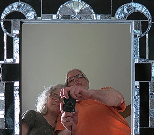 Margaret Almon and Wayne Stratz reflected in their first collaborative mirror