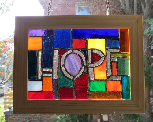Hope Immersed in a rainbow of glass by Wayne Stratz