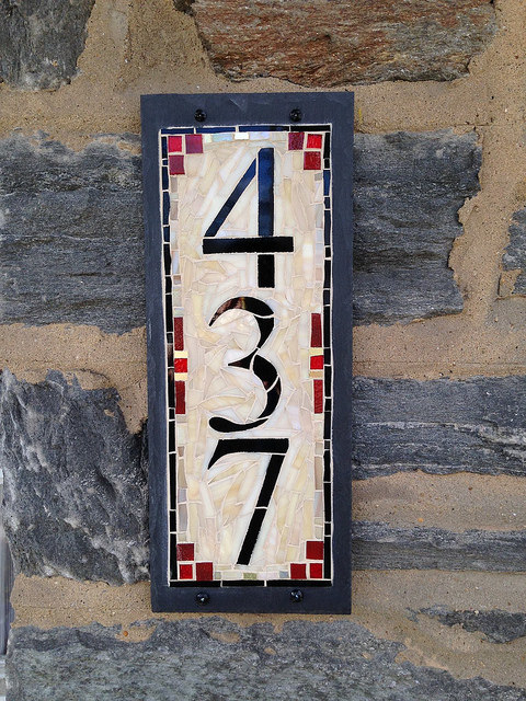 House Numbers for a Stone Home with a Red Door