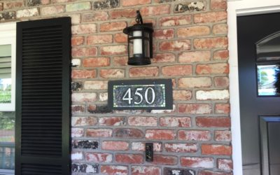 House Number Designed to Gracefully Cover a Hole in the Brick
